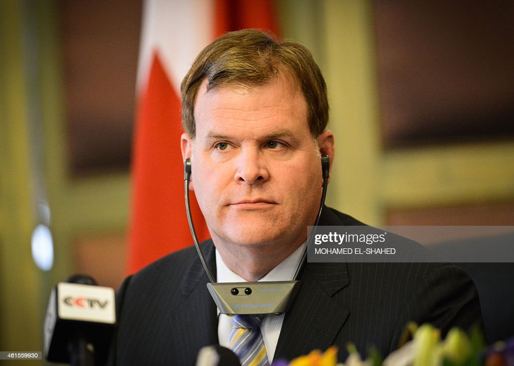Canada's Foreign Minister <a gi-track='captionPersonalityLinkClicked' href=/galleries/search?phrase=John+Baird+-+Canadian+Politician&family=editorial&specificpeople=10720753 ng-click='$event.stopPropagation()'>John Baird</a> listens on during a press conference with his Egyptian counterpart Sameh Shoukry in Cairo on January 15, 2015, after their meeting to discuss bilateral relations and the release of Canadian journalist Mohamed Fahmy imprisoned with two Al-Jazeera colleagues in Egypt. Baird played down expectations that his visit could see Canadian-Egyptian Fahmy freed imminently after more than a year in jail. AFP PHOTO / MOHAMED EL-SHAHED