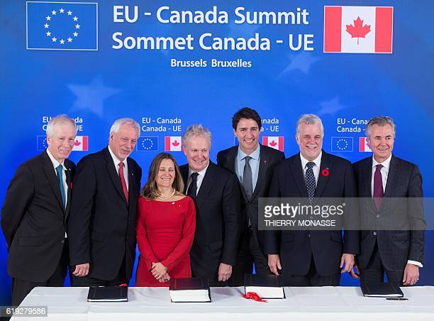 Canada's Foreign Minister Stephane Dion Quebec's former Premier Pierre Marc Johnson Canada's International Trade Minister Chrystia Freeland Quebec's...