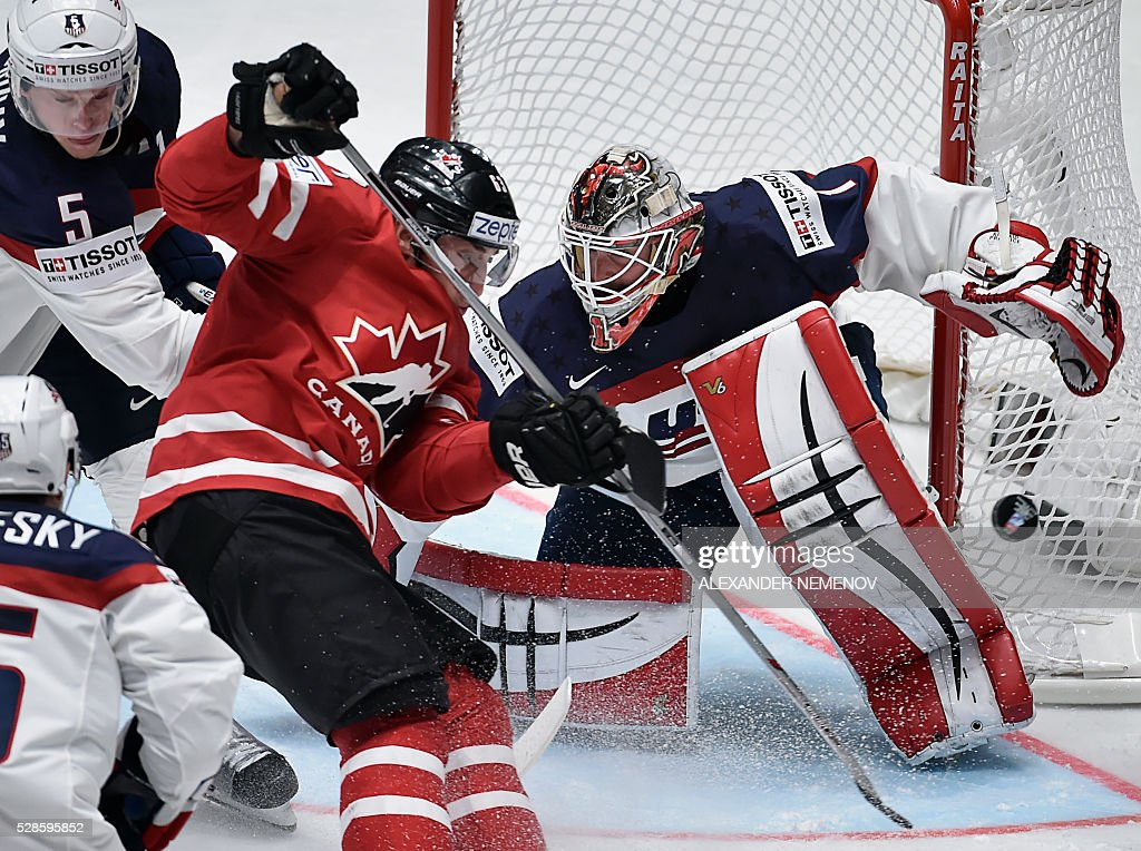 Canada's forward Brad Marchand (C) attacks the net of US goalie Keith Kinkaid during the group B preliminary round game USA vs Canada at the 2016 IIHF Ice Hockey World Championship in St. Petersburg on May 6, 2016. / AFP / ALEXANDER