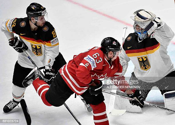 Canada's forward Brad Marchand vies with Germany's defender Sinan Akdag and Germany's goalie Timo Pielmeier during the group B preliminary round game...