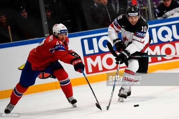 Canada's forward Brayden Schenn vies with Norway's defender Henrik Odegaar during the IIHF Men's World Championship group B ice hockey match between...