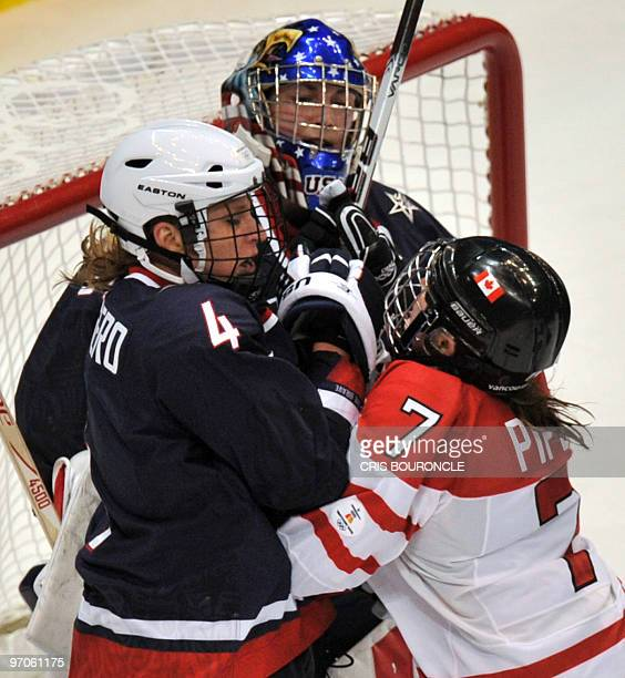 Canada's forward Cherie Piper slams into USA's goalkeeper Jessie Vetter and USA's defence Angela Ruggiero during the Women's Gold Medal Hockey game...