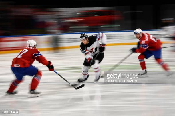 TOPSHOT Canada's forward Claude Giroux vies with Norway's defender Henrik Odegaar and Norway's Aleksander Reichenberg during the IIHF Men's World...