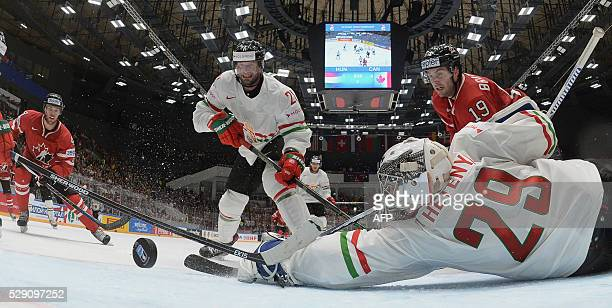 Canada's forward Derick Brassard scores past Hungary's goalie Zoltan Hetenyi during the group B preliminary round game Hungary vs Canada at the 2016...