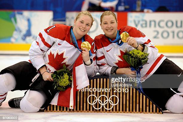 Canada's forward Haley Irwin and forward Cherie Piper show off their gold medals during the medals ceremony following their win over the USA in the...