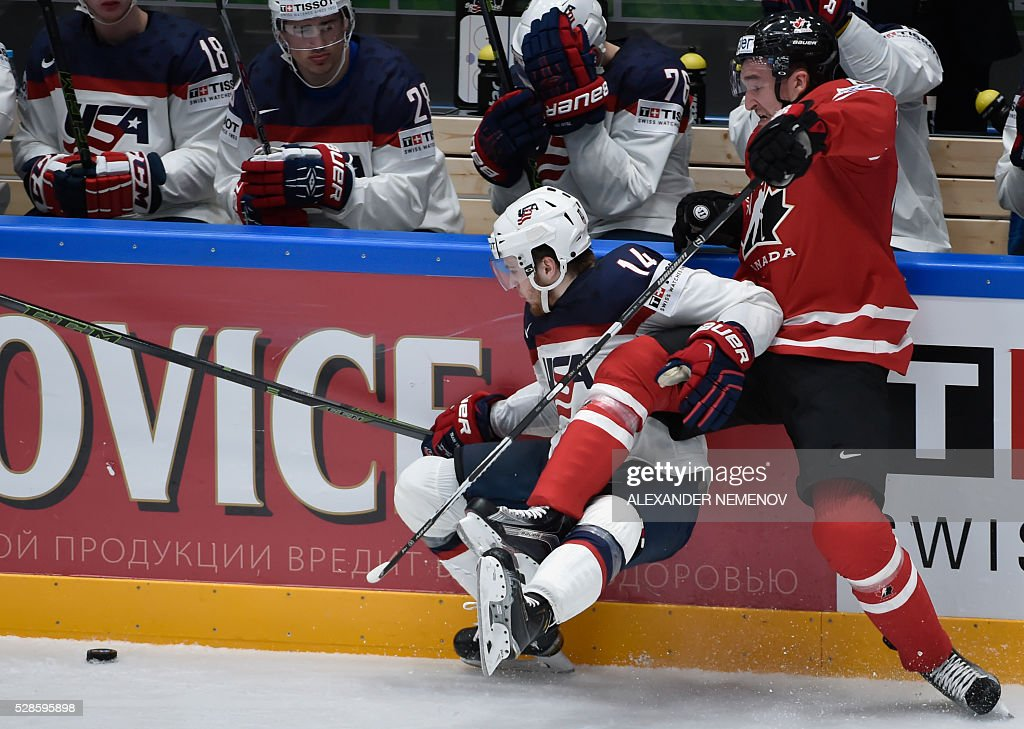 Canada's forward Mark Stone (R) vies with US forward Tyler Motte during the group B preliminary round game USA vs Canada at the 2016 IIHF Ice Hockey World Championship in St. Petersburg on May 6, 2016. / AFP / ALEXANDER