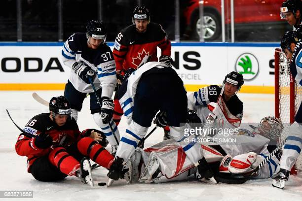 Canada's forward Mitch Marner and Finland's goalkeeper Harri Sateri vie for the puck during the IIHF Men's World Championship group B ice hockey...