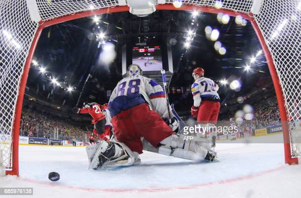 Canada´s forward Nate MacKinnon scores past Russia´s goalkeeper Andrei Vasilevski during the IIHF Men's World Championship Ice Hockey semifinal match...