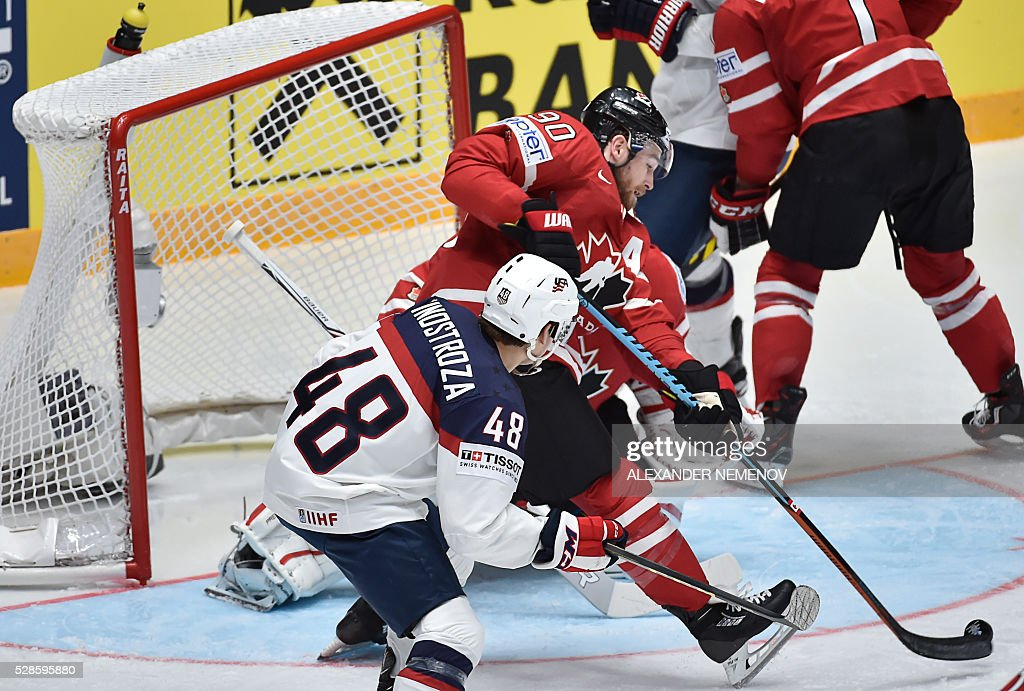 Canada's forward Ryan O'Reilly (C) saves his net during the group B preliminary round game USA vs Canada at the 2016 IIHF Ice Hockey World Championship in St. Petersburg on May 6, 2016. / AFP / ALEXANDER