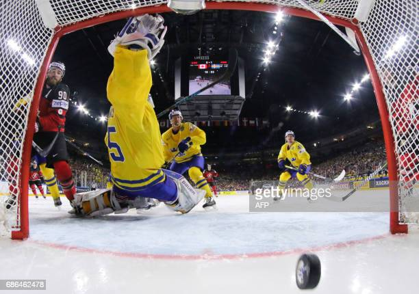 Canada´s forward Ryan O´Reilly scores during the IIHF Ice Hockey World Championships final between Canada and Sweden in Cologne western Germany on...