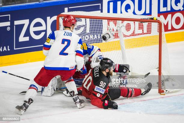 Canada´s forward Ryan O´Reilly takes the goal with him as he slides on the ice during the IIHF Men's World Championship Ice Hockey semifinal match...