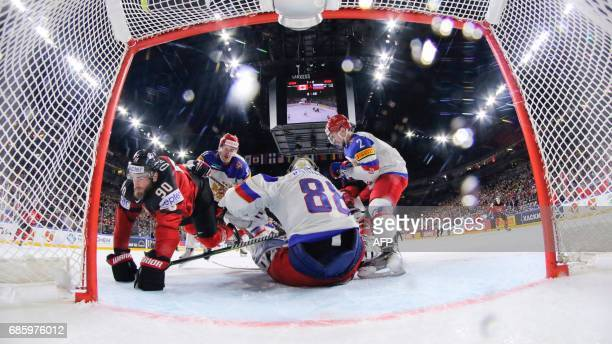 Canada´s forward Ryan O´Reilly trips over Russia´s goalkeeper Andrei Vasilevski during the IIHF Men's World Championship Ice Hockey semifinal match...