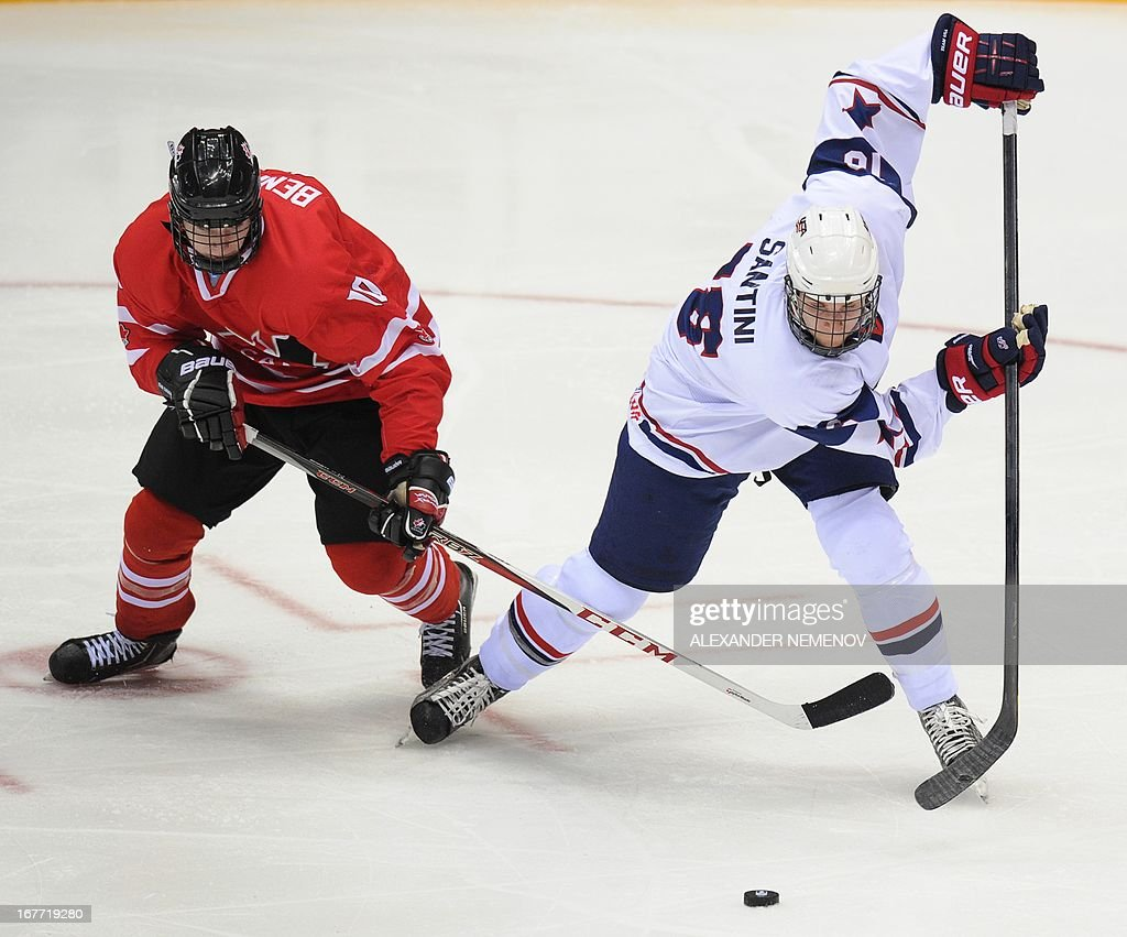 Canada's forward Samuel Bennett (L) vies with US defender Steven Santini during the IIHF U18 International Ice Hockey World Championships final game in Sochi on April 28, 2013.