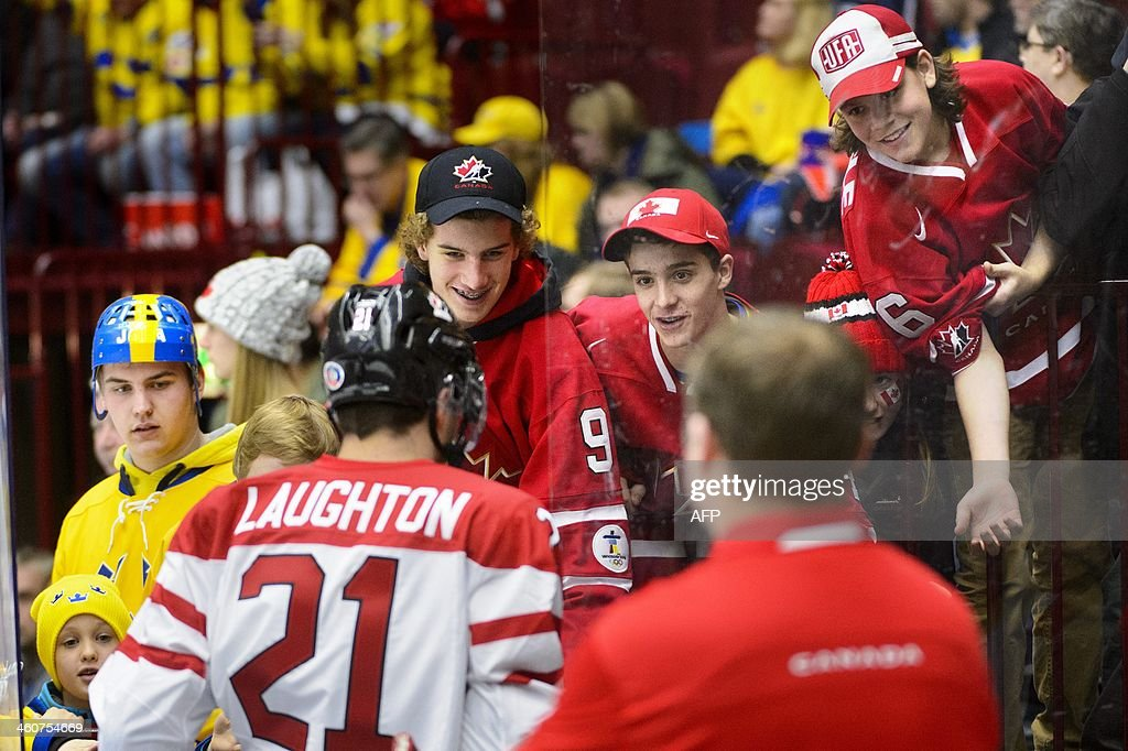 Canada's forward Scott Laughton talks to supporters prior to the World Junior Hockey Championships bronze medal match between Canada and Russia at Malmo Arena in Malmo, Sweden on January 5, 2014. AFP PHOTO / TT NEWS AGENCY / LUDVIG THUNMAN +++ SWEDEN OUT +++