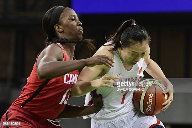 Canada's forward Tamara Tatham blocks China's small forward Shao Ting during a Women's round Group A basketball match between China and Canada at the...