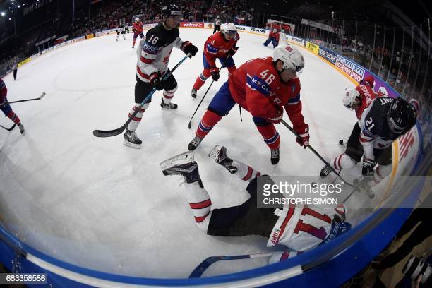 Canada's forward Travis Konecny lies on the ice as Canada's forward Brayden Point vies with Norway's forward Mathis Olimb during the IIHF Men's World...