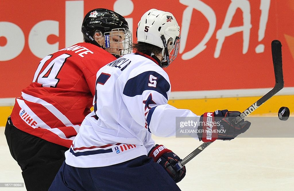 Canada's forward Yan Laplante (L) vies with US defender Tommy Vannelli during the IIHF U18 International Ice Hockey World Championships final game in Sochi on April 28, 2013.