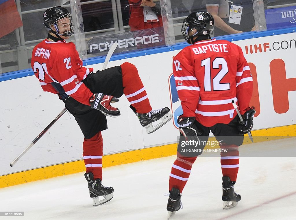 Canada's forwards Laurent Dauphin (L) and Nick Baptiste celebrate after scoring during the IIHF U18 International Ice Hockey World Championships final game in Sochi on April 28, 2013.