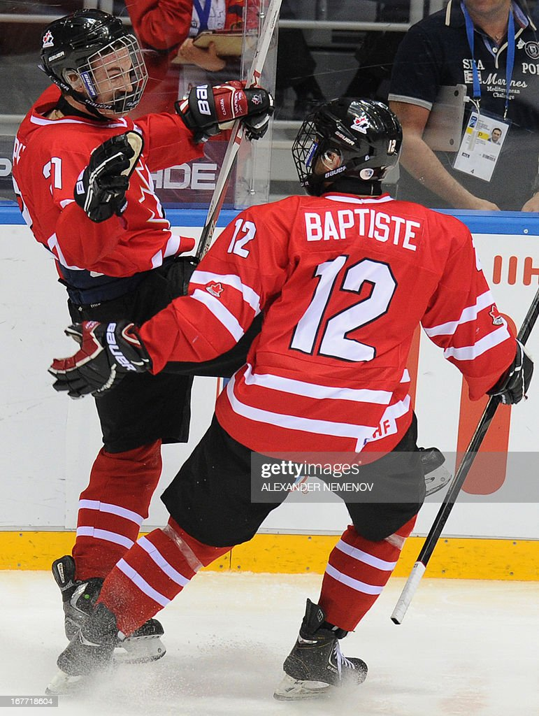 Canada's forwards Laurent Dauphin (L) is congratulated by his teammate Nick Baptiste after scoring during the IIHF U18 International Ice Hockey World Championships final game in Sochi on April 28, 2013.