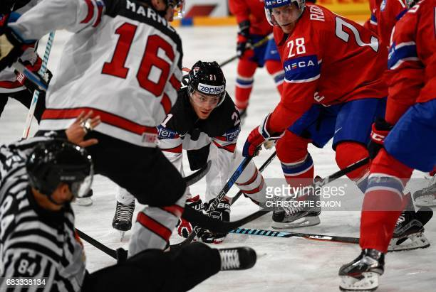 Canada's forwards Mitch Marner and Brayden Point vies with Norway's forward Niklas Roest during the IIHF Men's World Championship group B ice hockey...