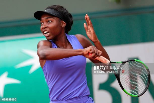 Canada's Francoise Abanda returns the ball to France's Tessah Andrianjafitrimo returns the ball to during their tennis match at the Roland Garros...