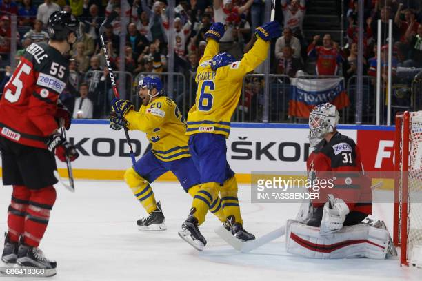 Canada's goalie Calvin Pickard misses a goal past Sweden's Marcus Kruger abd Sweden's Joel Lundqvist during the IIHF Men's World Championship Ice...