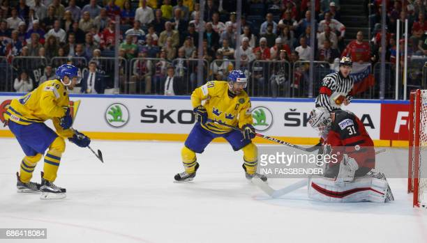 Canada's goalie Calvin Pickard misses a goal past Sweden's Marcus Kruger during the IIHF Men's World Championship Ice Hockey final game match between...
