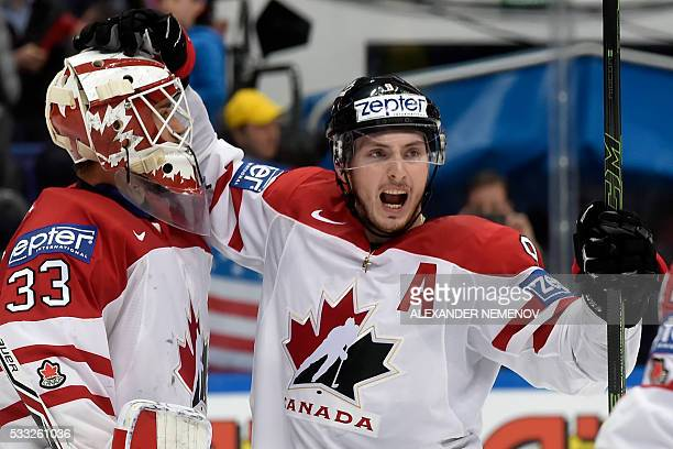 Canada's goalie Cam Talbot and forward Matt Duchene celebrate after winning the semifinal game Canada vs USA at the 2016 IIHF Ice Hockey World...