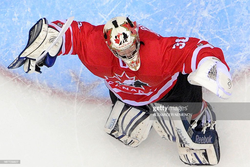 Canada's goalkeeper Philippe Desrosiers celebrates his team's 3-2 victiory over team USA during the IIHF U18 International Ice Hockey World Championships final game in Sochi on April 28, 2013.