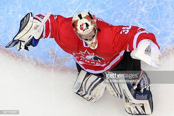 Canada's goalkeeper Philippe Desrosiers celebrates his team's 32 victiory over team USA during the IIHF U18 International Ice Hockey World...