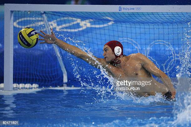 Canada's goalkeeper Robin Randall tries to stop the ball during a men's water polo quarterfinal match against Italy at 2008 Beijing Olympics Games in...