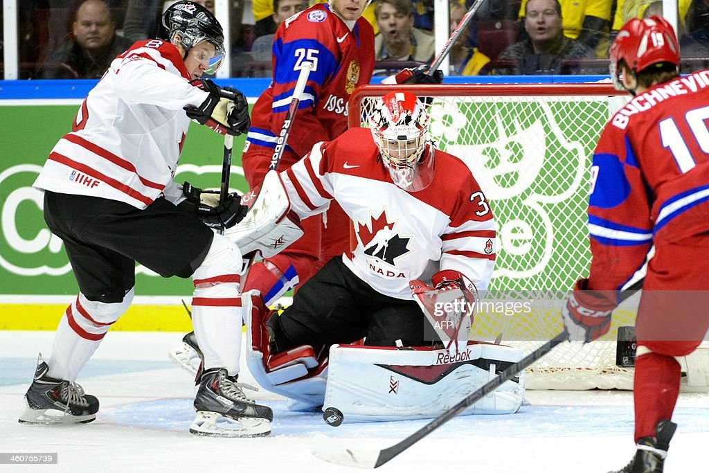 Canada's goalkeper Zachary Fucale (C) makes a save during the World Junior Hockey Championships bronze medal match between Canada and Russia at Malmo Arena in Malmo, Sweden on January 5, 2014. AFP PHOTO / TT NEWS AGENCY / LUDVIG THUNMAN +++ SWEDEN OUT +++