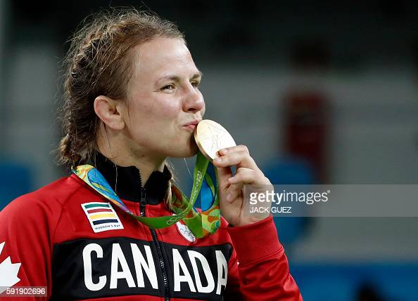Canada's gold medallist Erica Elizabeth Wiebe celebrates on the podium at the end of the women's 75kg freestyle wrestling event at the Carioca Arena...