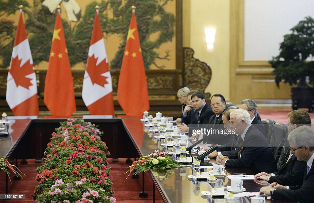 Canada's Governor General David Johnston (3rd R) talks to Chinese President Xi Jinping (not pictured) during a meeting at the Great Hall of the People in Beijing on October 18, 2013. Johnston's visit is aimed at boosting relations between Canada and China. AFP PHOTO / POOL / KOTA ENDO