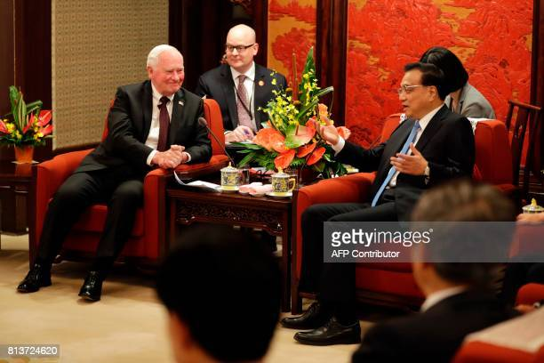 Canada's Governor General David Jonston listens to Chinese Premier Li Keqiang during a meeting at the Zhongnanhai Leadership Compound in Beijing on...
