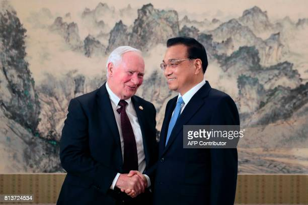 Canada's Governor General David Jonston shakes hands with Chinese Premier Li Keqiang before a meeting at the Zhongnanhai Leadership Compound in...