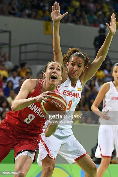 Canada's guard Kim Gaucher goes to the basket past Spain's point guard Laia Palau during a Women's round Group B basketball match between Spain and...