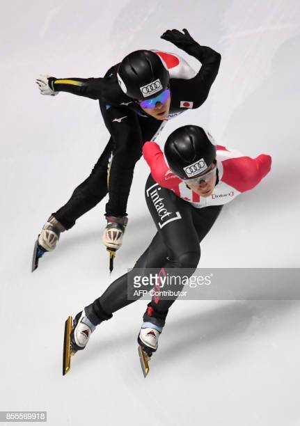 Canada's Jamie Macdonald and Japan's Sumire Kikuchi compete during their 'Ladies 3000 m relay' of the ISU Short Track Speed Skating World Cup at the...