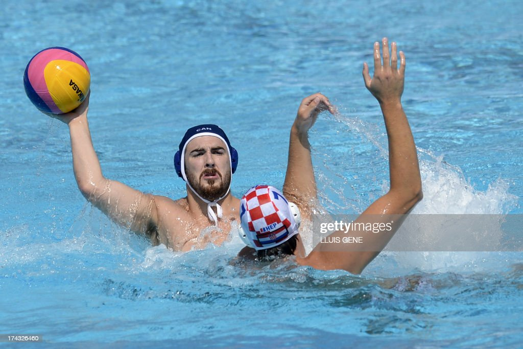 Canada's Jared Mcelroy (L) vies with Croatia's Petar Muslim (R) during the preliminary round match of the men's water polo competition between Croatia and Canada at the FINA World Championships at the Bernat Picornell swimming pool in Barcelona on July 24, 2013. AFP PHOTO/ LLUIS GENE
