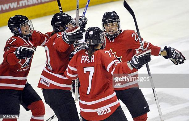 Canada's Jennifer Botteril Gillian Apps and Cherie Piper celebrate Tessa Bonhomme's goal during the USA Canada match at the women's 2009 Four Nations...