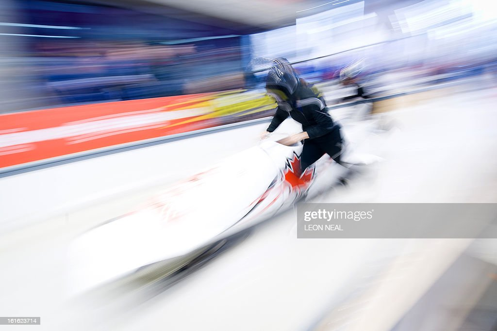 Canada's Jennifer Ciochetti pushes off during a training run for the Bobsleigh Women category of the FIBT Bob and Skeleton World Cup 2012/23 at the Sanki sliding centre, near Rzhanaya Polyana on February 13, 2013. With a year to go until the Sochi 2014 Winter Games, construction work continues as tests events and World Championship competitions are underway. AFP PHOTO / LEON NEAL