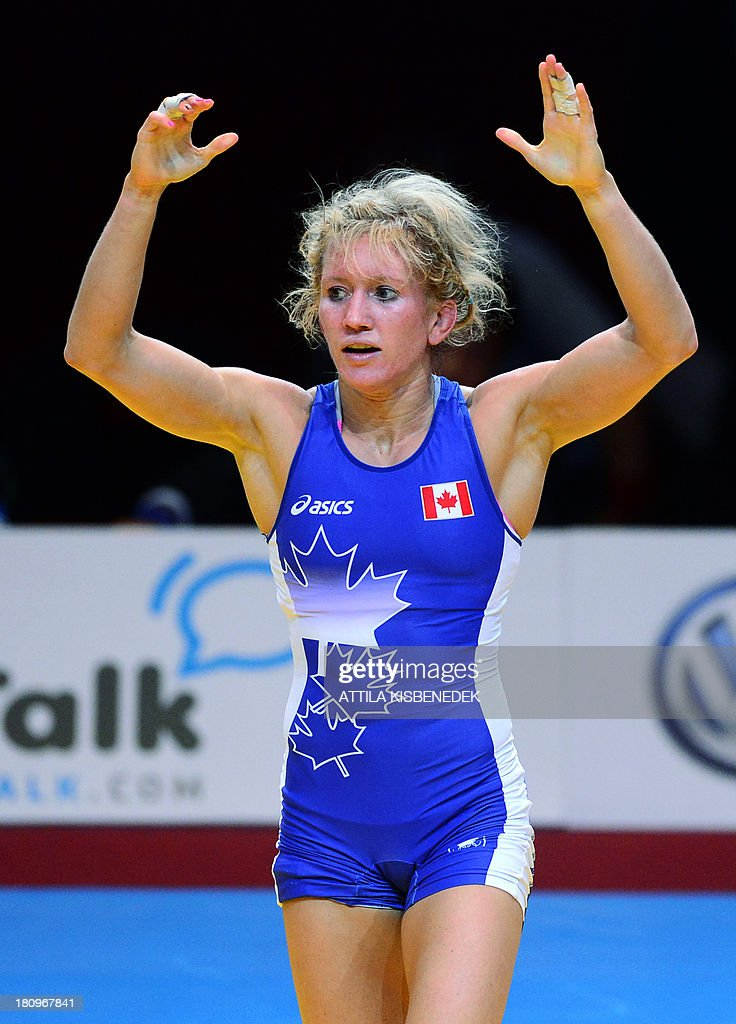 Canada's Jessica Macdonald Bondy celebrates her victory over Ukraine's Yuliya Blahinya (not pictured) after the women's free style 51 kg category bronze medal match of the FILA World Wrestling Championships in Budapest on September 18, 2013. Macdonald Bondy won te bronze medal.