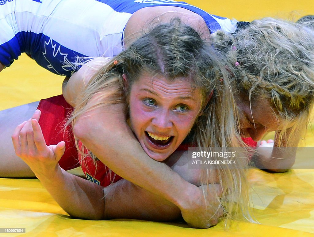 Canada's Jessica Macdonald Bondy (R) fights against Ukraine's Yuliya Blahinya in the women's free style 51 kg category bronze medal match of the FILA World Wrestling Championships in Budapest on September 18, 2013. Macdonald Bondy won te bronze medal.