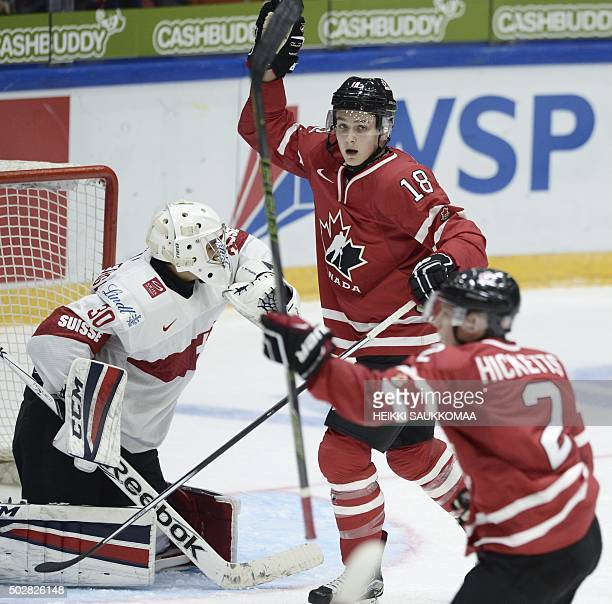 Canada's Joe Hicketts and Jake Virtanen celebrate the 22 goal by Hicketts behind the goal of Switzerland's goalie Joren von Pottelberghe during the...