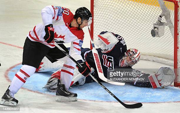 Canada's John Tavers scores past US goalkeeper Jimmy Howard during their preliminary round game of the IIHF International Ice Hockey World...