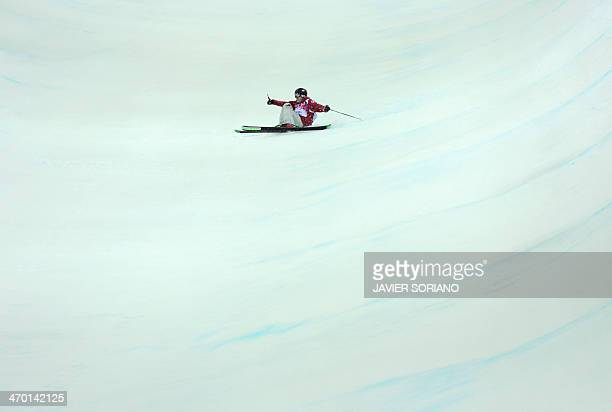 Canada's Justin Dorey falls in the Men's Freestyle Skiing Halfpipe finals at the Rosa Khutor Extreme Park during the Sochi Winter Olympics on...