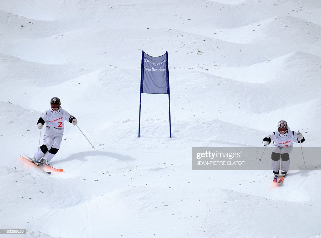 Canada's Justine Dufour Lapointe (L) and Chloe Dufour Lapointe compete in the ladies' Moguls final of the Freestyle Skiing World Cup on march 15, 2015 at Megeve (Haute-Savoie) ski resort, French Alps. AFP PHOTO / Jean-Pierre Clatot