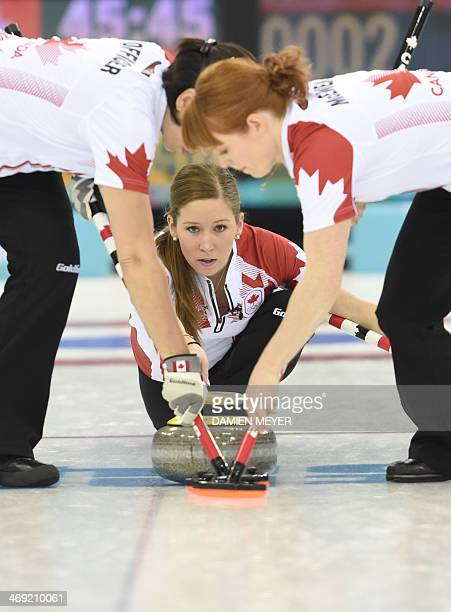 Canada's Kaitlyn Lawes throws the stone during the Women's Curling Round Robin Session 6 against Switzerland at the Ice Cube Curling Center during...