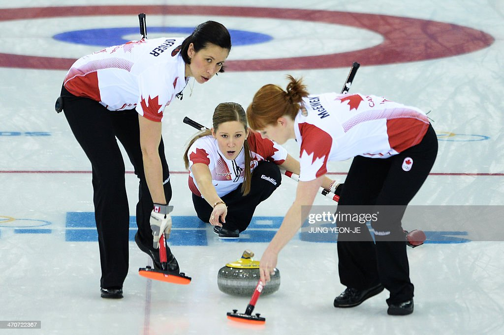 Canada's Kaitlyn Lawes throws the stone in the Women's Curling Flower Ceremony at the Ice Cube Curling Center during the Sochi Winter Olympics on...