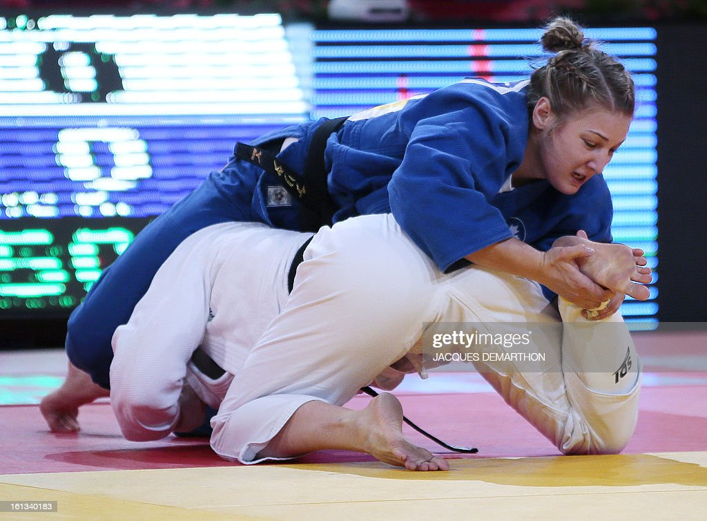 Canada's Kelita Zupancic (up) fights against France's Marie Pasquet on February 10, 2013 in the women's 70kg category semi-finals during the Paris International Judo tournament, part of the Grand Slam, at the Palais Omnisports de Paris-Bercy (POPB). AFP PHOTO / JACQUES DEMARTHON